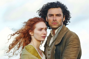 TV STILL -- DO NOT PURGE -- Poldark   Sundays, June 21 - August 2, 2015 on MASTERPIECE on PBS   Ross Poldark rides again in a swashbuckling new†adaptation of the hit series that helped launch MASTERPIECE in the†1970s. Aidan†Turner (The Hobbit) stars as Captain Poldark, a redcoat who returns to†Cornwall after the American†Revolution and finds that his fighting days are far†from over. Robin Ellis, who played Poldark in the 1970s PBS adaptation,†appears in†the role of Reverend Halse. Eleanor Tomlinson (MASTERPIECE ìDeath Comes to Pemberleyî) plays the spunky Cornish minerís†daughter taken†in by the gallant captain.†  Shown from left to right: Eleanor Tomlinson as Demelza and Aidan Turner as Ross Poldark  (C) Robert Viglasky/Mammoth Screen for MASTERPIECE  This image may be used only in the direct promotion of MASTERPIECE. No other rights are granted. All rights are reserved. Editorial use only.
